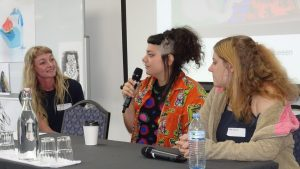 Young women speaking on panel